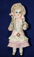 #824 Antique Reproduction Daisy in Pink Ruffled Dress: 3-1/2""